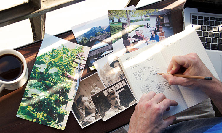 Daylight web designer sifting through historical photos